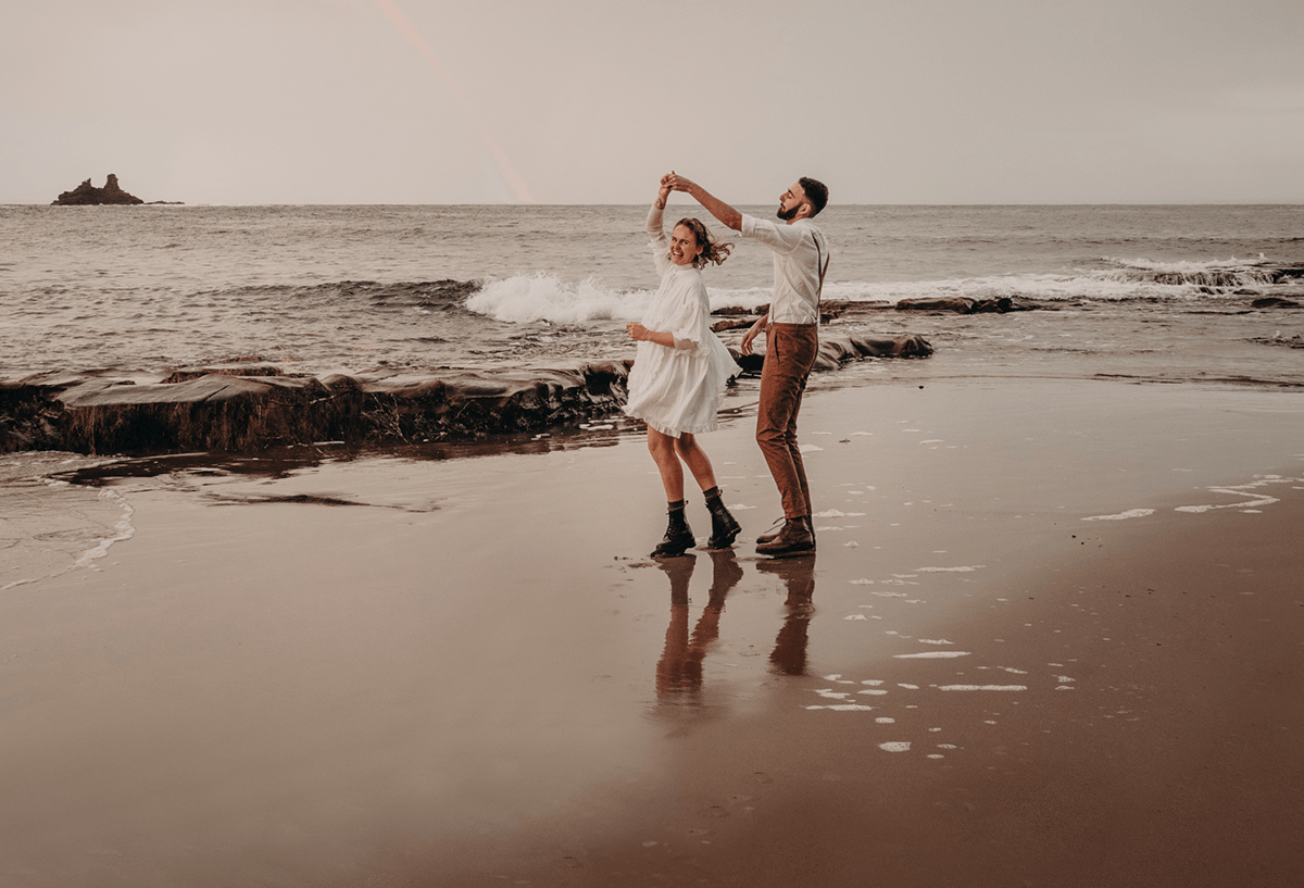 Image of rad couple, beach dance